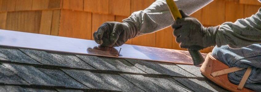 Worker Installing Asphalt Shingles